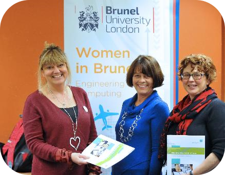 Three women in front of Brunel University banner
